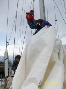 Ian and Clare putting the main sail on