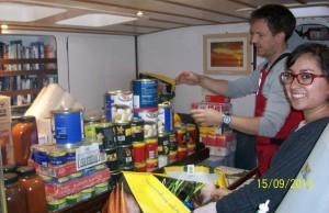 Fabiola and Jon sorting through some of the food.