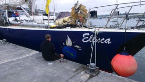 Tom helping Jim with the boat stickers
