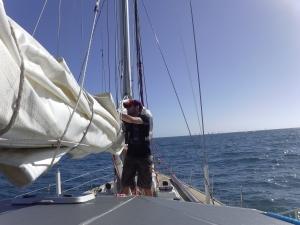 Jim prepares to hoist the mainsail.
