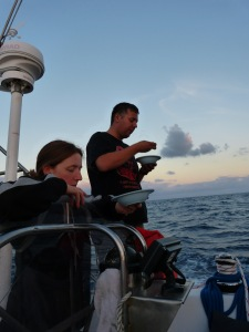 Clare and James enjoying Nick's roasted pineapple supper as the sun set... somewhere in the middle.