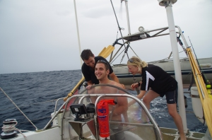 Tickling helmsman Chris in attempt to put him off his course