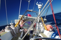 Katrina, new crew member looking at home on the wheel after just one day.